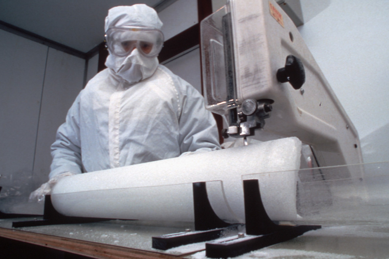 Cutting an ice core for analysis in the cold room at the British Antarctic Survey headquarters, Cambridge