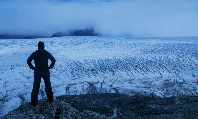 Man surveys the expanse of the landscape