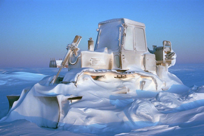 Bulldozer encased in snow