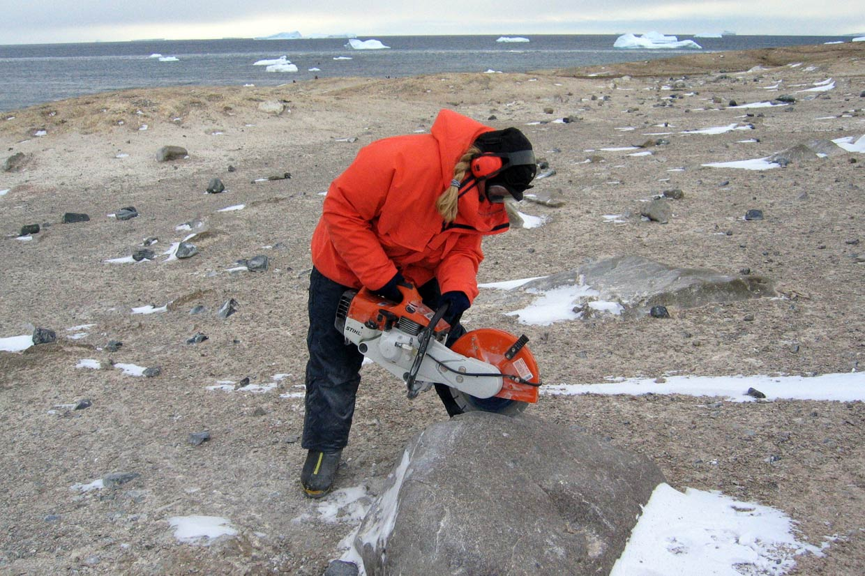 BAS geologist Joanne Johnson sampling a granitoid boulder for surface exposure dating using cosmogenic isotopes. © British Antarctic Survey, Joanne Johnson