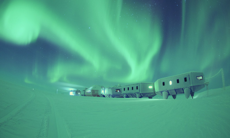 Halley Research Station with green southern lights