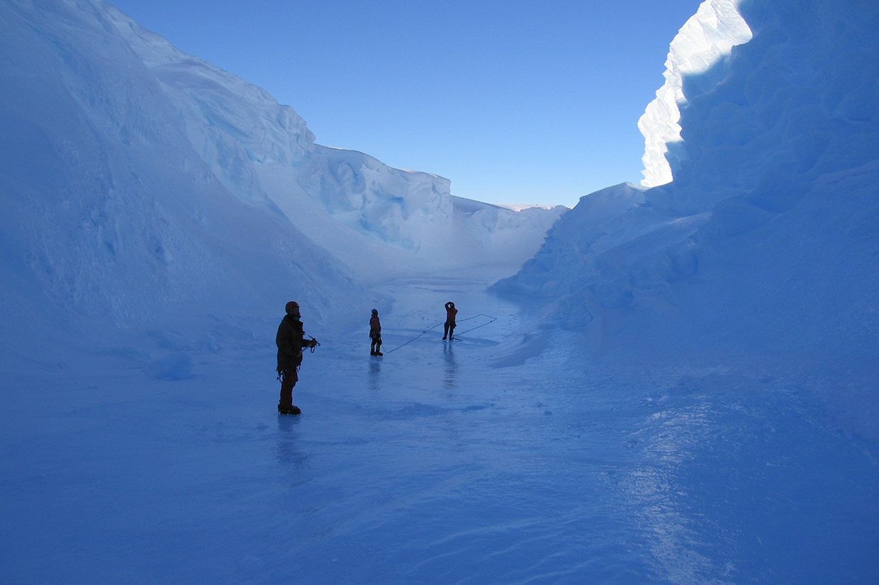 tourist walking in the crevice of a glacier