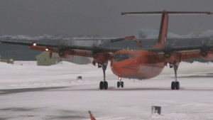 Watching the swaying approach and perfect landing of a DASH 7 bright orange 4 propellor aircraft all in high winds